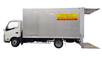 Large truck with lifter for hire sideview